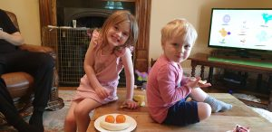 Annabel and John decorate with fruit.