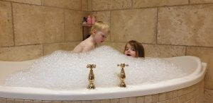 John and Annabel in a very bubbly bath.