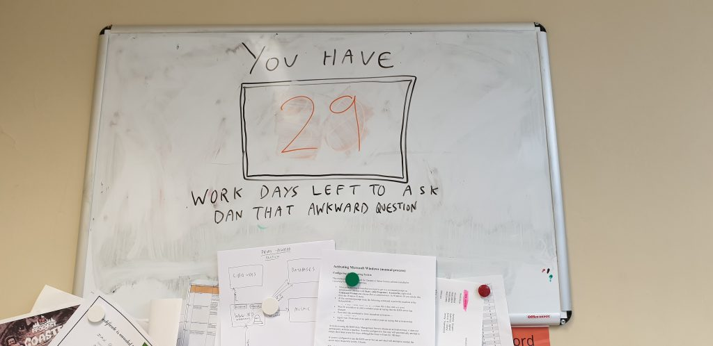 "Dan's whiteboard: ""You have [29] work days left to ask Dan that awkward question""."