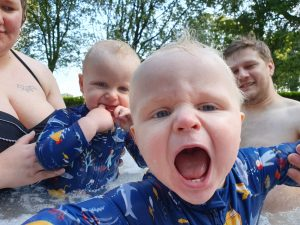 The twins, excited, in the hot tub.