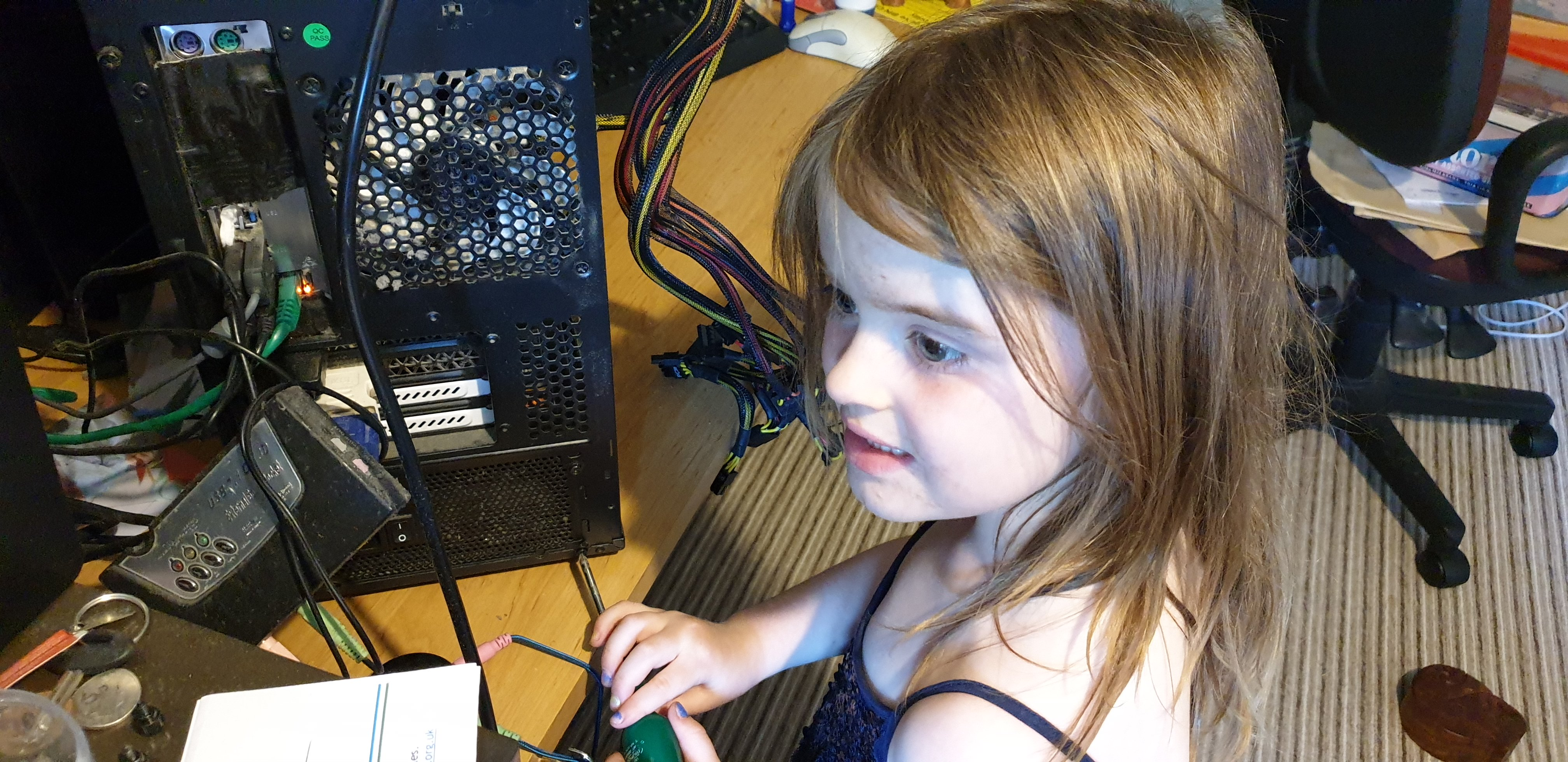 Annabel repairing her mother's computer.