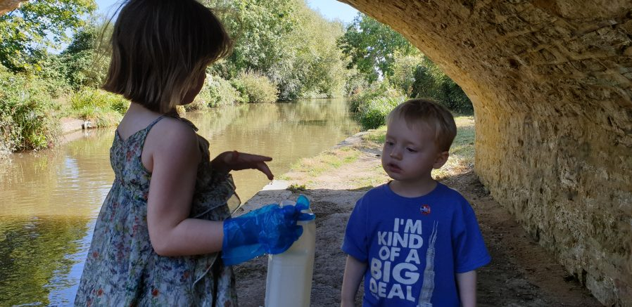 Annabel and John assess the colour of the canal water.