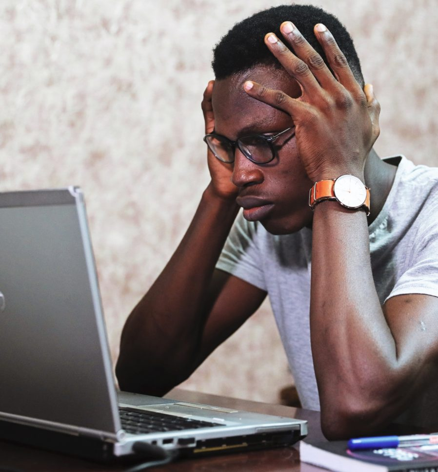 Man staring intently at laptop. Image courtesy Oladimeji Ajegbile, via Pexels.