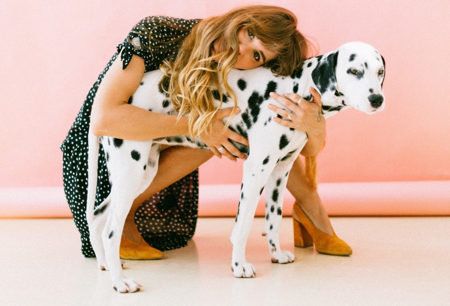 Woman hugging a dalmatian. Photo by Daria Shevtsova from Pexels.