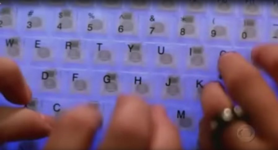 Four hands on one keyboard, from CSI: Cyber