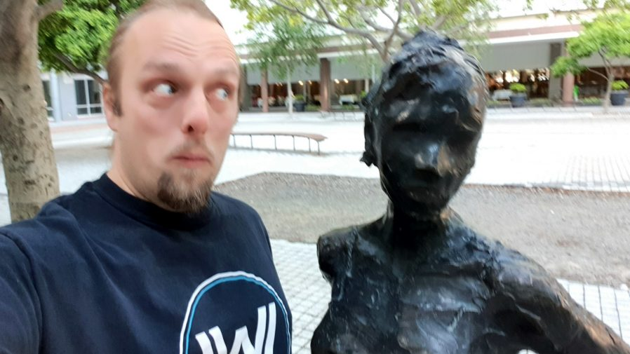 Dan with a statue at the GZ