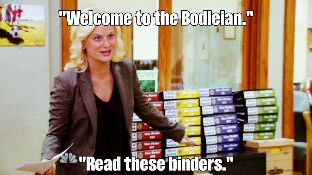 Leslie Knope (Parks & Rec) presents a pile of binders, saying