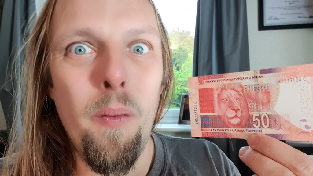 Dan with a 50 South African Rand note.