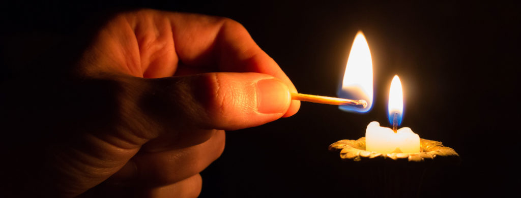 A candle being lit.