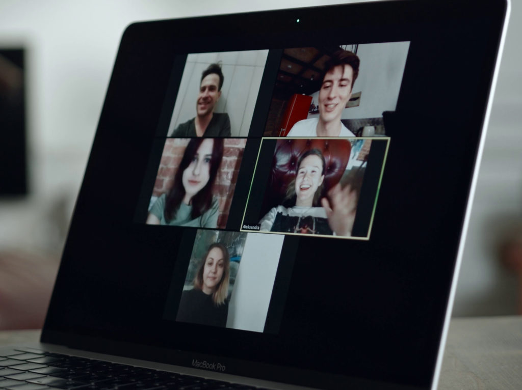 Laptop screen showing five people videoconferencing.