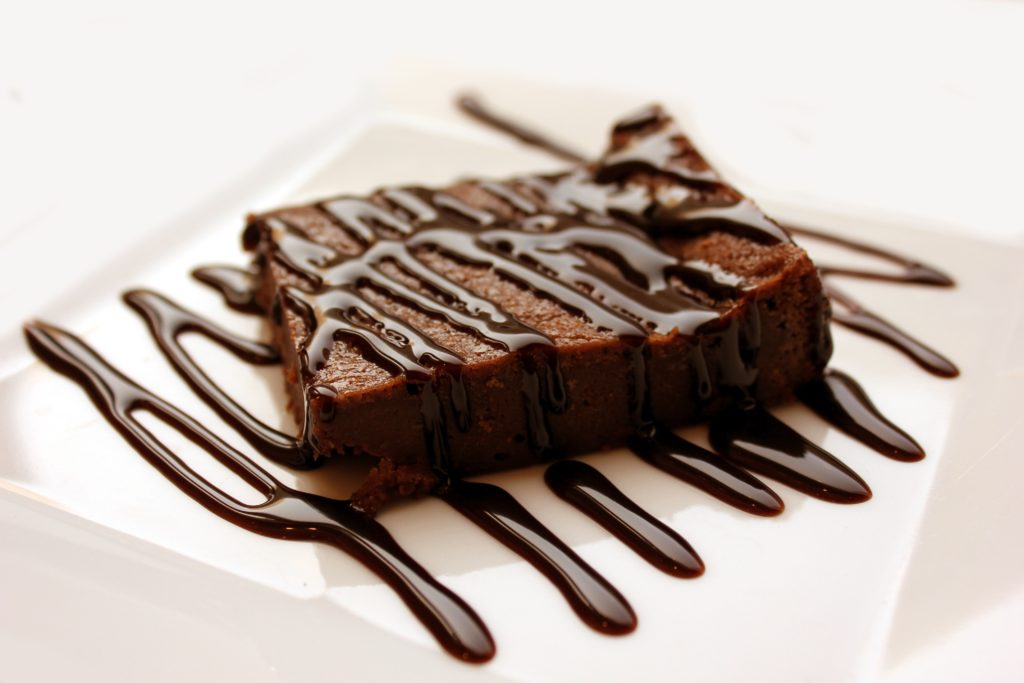 Chocolate brownie with melted chocolate sauce.