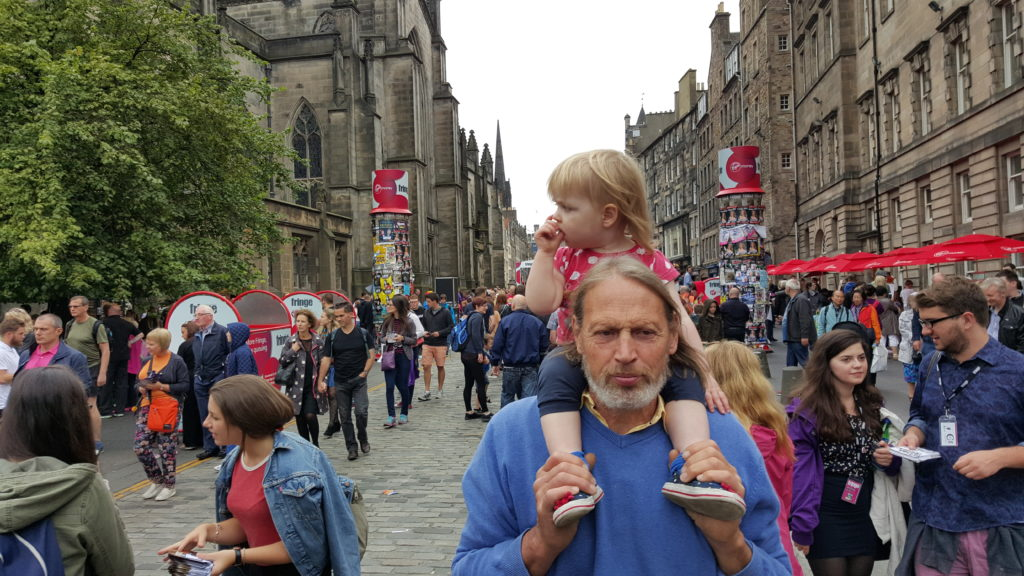 Annabel riding on Tom's shoulders in Edinburgh.