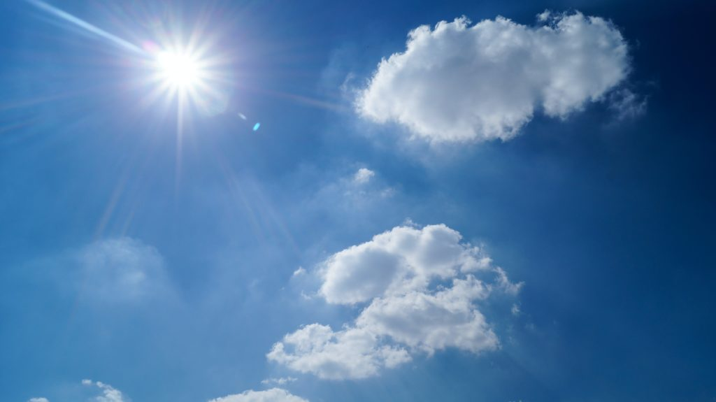 Bright sunlight in an almost-cloudless blue sky.