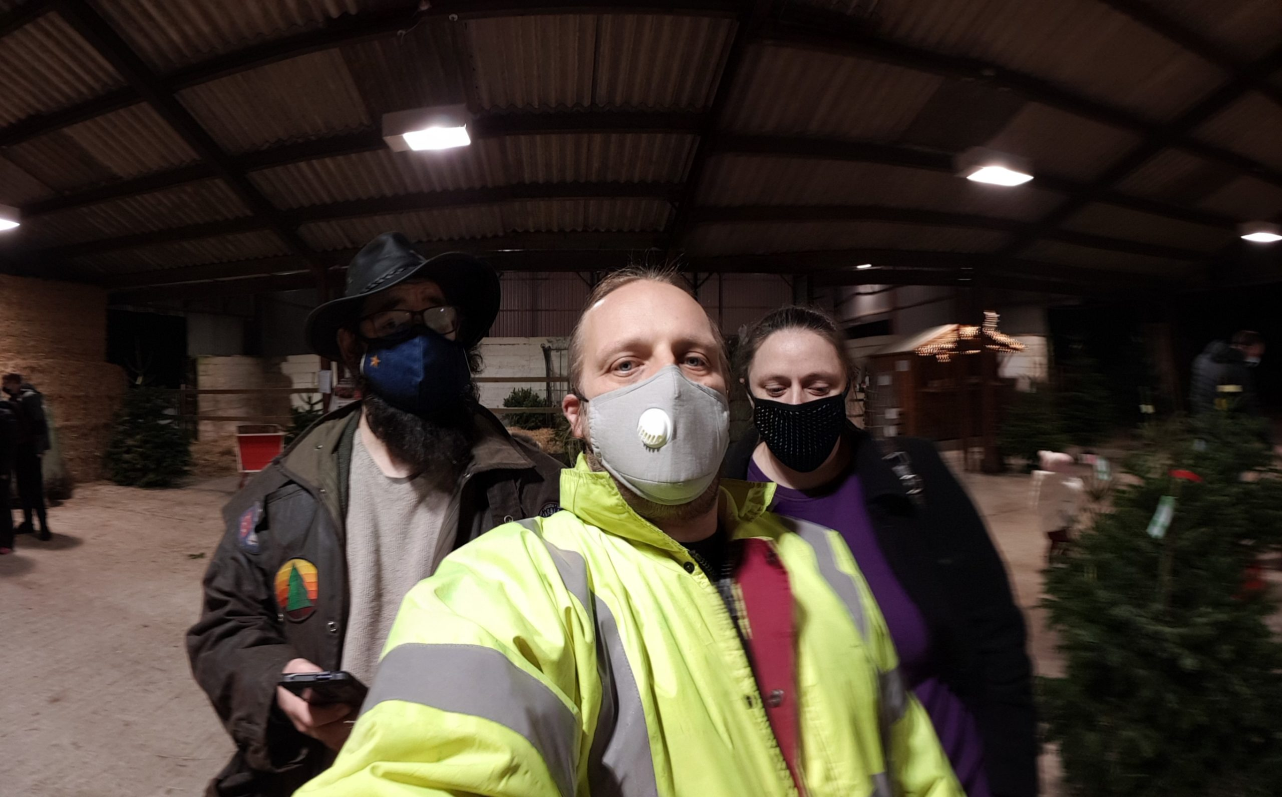 JTA, Dan and Ruth shopping for a Christmas tree, wearing face masks