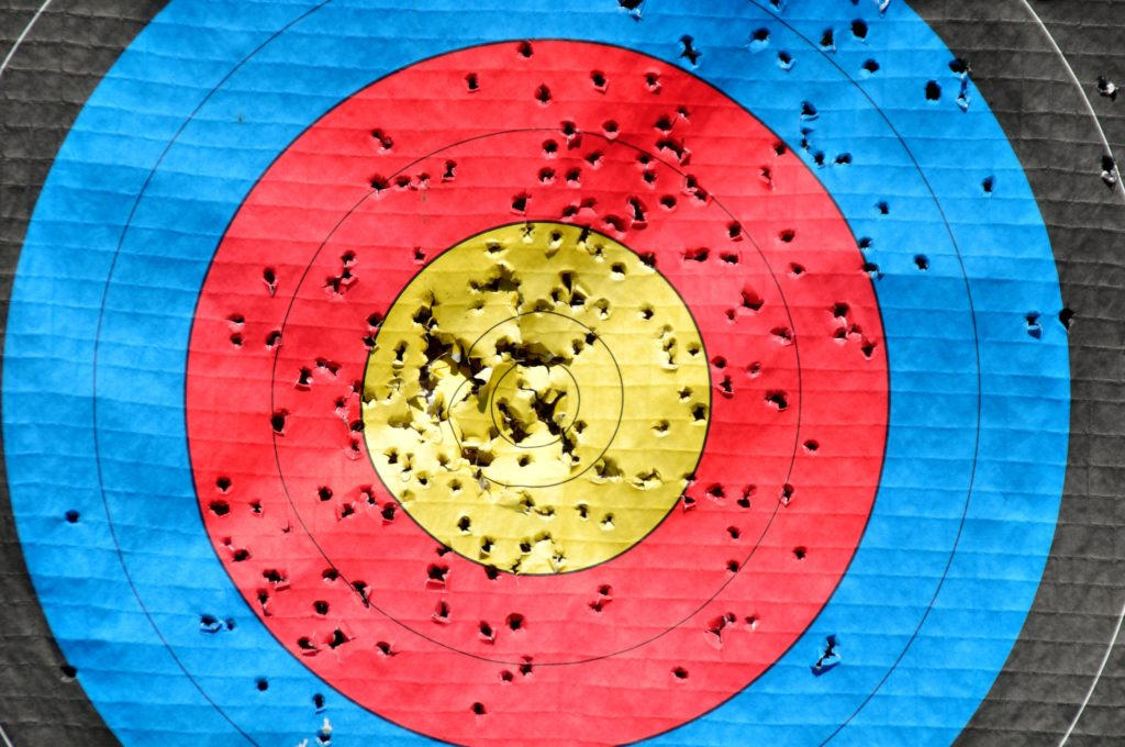 A shooting target with a great many holes.