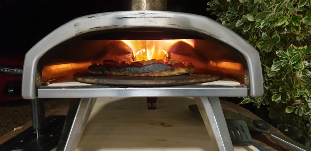 Pizza on fire in oven.
