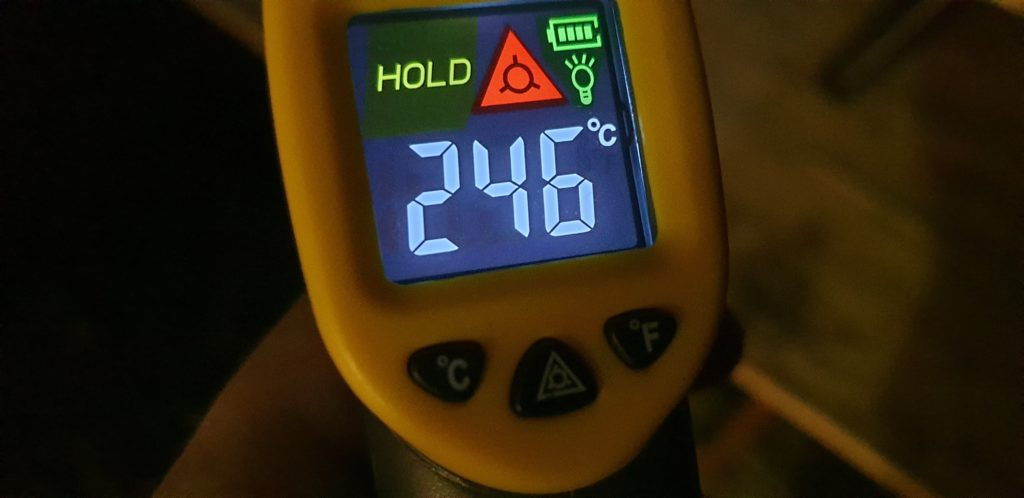 Digital infared thermometer display reading 246ºC.