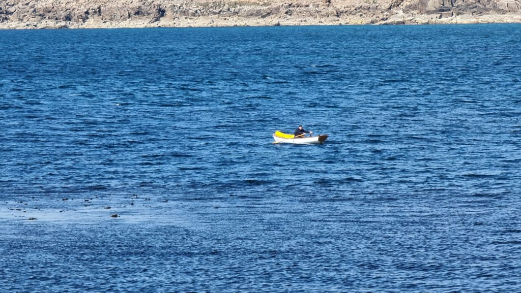 Robin rows away from Sennen Cove and towards St. Ives