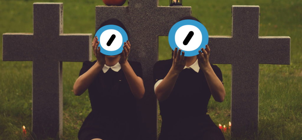 Two women in black dresses sit in a graveyard by candlelight and hold up the Automattic logo. Edited image based on original photo by Valeria Boltneva from Pexels (used with permission) and the Automattic logo (used under the assumption that they won't mind, given the context).