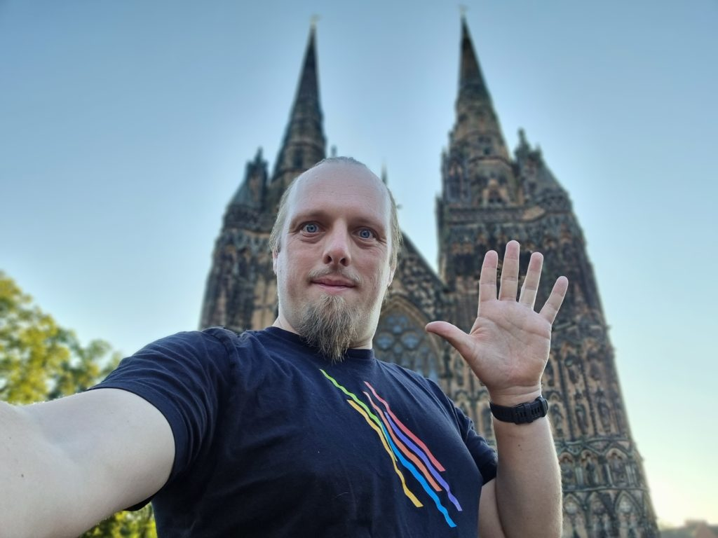 Dan in froint of Lichfield Cathedral, waving