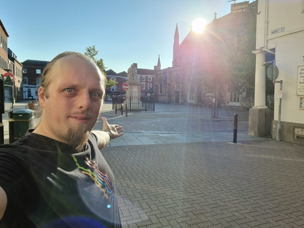 Dan near the corner of the Samuel Johnson Birthplace Museum in Lichfield, in a deserted public square early in the morning.
