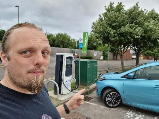 Dan points to his car, plugged in to a charger.