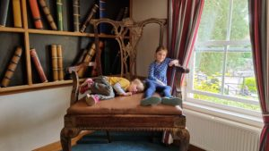 The kids on an enormous chair.