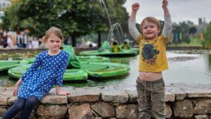 """Kids at the """"frog"""" fountains near the entrance to Alton Towers' theme park."""