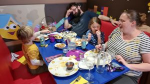 Ruth, JTA and the kids eat dinner.