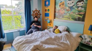JTA and the kids relaxing in our Octonauts-themed hotel room.