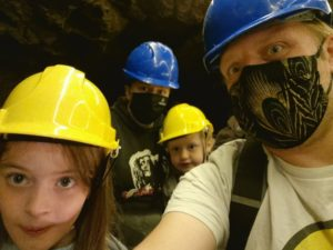 Dan, Ruth and the kids in a boat down a cave.