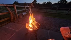 A fire pit rages and sparks.