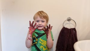 Boy with painted brown hands.