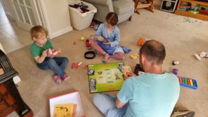 Children watch as our 7-year-old plays Pokemon with Simon.