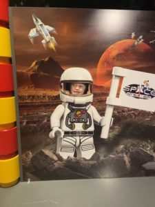 Child in a lego space suit.
