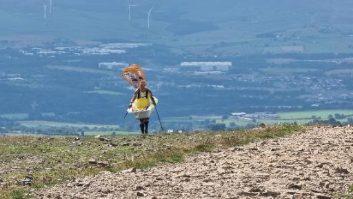 Steve Taylor climbing Pendle Hill carrying a bathtub for at least the second time this morning.